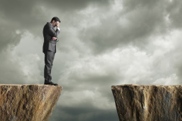 Man on cliff gap